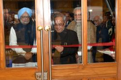 New Delhi: President Pranab Mukherjee inaugurates the Ceremonial Hall, at the President's Estate, in New Delhi on Dec 12, 2014. Also seen Prime Minister Narendra Modi and former prime minister Dr. ...