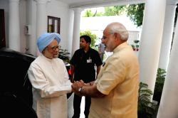 New Delhi: Prime Minister Narendra Modi welcomes former prime minister Dr. Manmohan Singh at his official residence in New Delhi, on May 27, 2015.