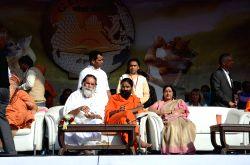 New Delhi: Swami Gyananand Sarswati with Baba Ramdev and External Affair Minister Sushma Swaraj during Geeta Prerna Utsav on  occasion of 5151 years of Shri Bhagwat Geeta at Red Fort ground in New ...