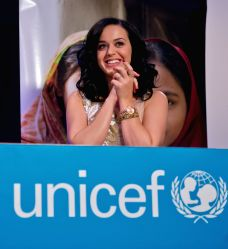 Singer Katy Perry reacts after being appointed UNICEF Goodwill Ambassador at the UNICEF headquarters in New York, U.S., on Dec. 3, 2013. Katy Perry will focus .