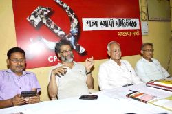CPI(ML)-Liberation General Secretary Dipankar Bhattacharya and other party workers during a party meeting in Patna on June 9, 2015.