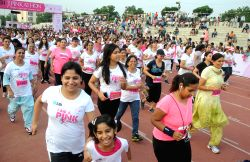 People participate in SBI Pinkathon Delhi 2014 at Jawaharlal Nehru Stadium in New Delhi on Sept 14, 2014.