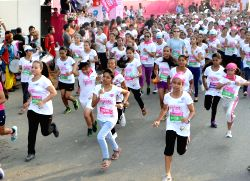 People participate in SBI Pinkathon in Guwahati, on Sep 27, 2015.