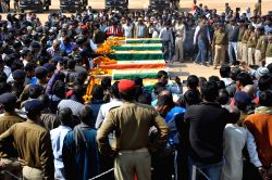 Policemen pay tribute to their colleagues killed in a landmine blast allegedly triggered by banned Maoist group, CPI-Maoist, near Kalapahari area in Jharkhand's Palamau district on Jan 28, ...