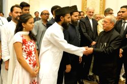 President Pranab Mukherjee meets the invitees at an Iftar party on the occasion of Id'ul Fitar hosted by him at Rashtrapati Bhawan in New Delhi, on June 23, 2017.