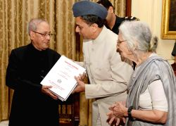 President Pranab Mukherjee receives the first copy of book 'Garuda Purana' (Critical Edition) published by the All India Kashiraj Trust at Rashtrapati Bhavan in New Delhi on June 19, 2017.