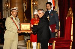 President Pranab Mukherjee with an IPS officer at Rashtrapati Bhavan in New Delhi on Jan.3, 2014. (Photo: Amlan Paliwal/IANS)