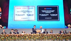 Prime Minister Narendra Modi along with Japanese Prime Minister Shinzo Abe lay foundation stone for Lithium-ion Battery Manufacturing Facility and inaugurate Suzuki Motor Vehicle ...