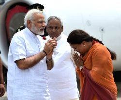 Prime Minister Narendra Modi being received by Rajasthan Governor Kalyan Singh and Chief Minister of Rajasthan Vasundhara Raje on his arrival at Udaipur in Rajasthan on Aug 29, 2017.