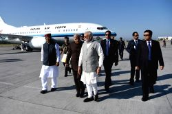 Prime Minister Narendra Modi being welcomed by the Governor of Uttarakhand, K.K. Paul and the Chief Minister of Uttarakhand, Shri Trivendra Singh Rawat, on his arrival, at Dehradun, ...