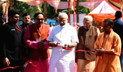 Prime Minister Narendra Modi inaugurates the 'Pashudhan Arogya Mela' at Shahanshahpur in Varanasi, Uttar Pradesh on Sept 23, 2017. Also seen Uttar Pradesh Governor Ram Naik, Chief Minister ...