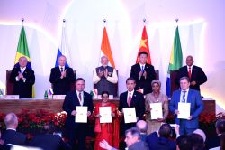 Prime Minister Narendra Modi, Russian President Vladimir Putin, Chinese President Xi Jinping, South African President Jacob Zuma and Brazilian President Michel Temer witness the signing of ...