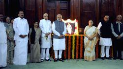 Prime Minister Narendra Modi with External Affairs Minister Sushma Swaraj, the Union Minister for Urban Development, Housing and Urban Poverty Alleviation and Parliamentary Affairs M. Venkaiah Naidu,
