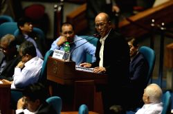 QUEZON CITY, July 22, 2017 - Philippine Defense Secretary Delfin Lorenzana (C) speaks during a joint session inside the Philippine House of Representatives in Quezon City, the Philippines, July 22, ...