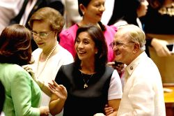 QUEZON CITY, May 30, 2016 - Philippine vice presidential winner Leni Robredo (C) is congratulated by congressmen during the proclamation of president and vice president at the House of ...