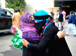 RAWALPINDI, April 3, 2015 (Xinhua) -- Pakistani women hug each other after they evacuated from Yemen at Benazir Bhutto International Airport in Rawalpindi, Pakistan, April 3, 2015. A group of 176 ...