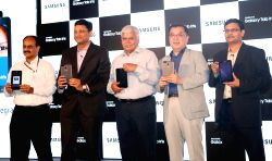 Samsung India electronic, senior vice president Ken Kang, vice president Sukesh Jain, and TRAI chairman RS Sharma during the launch of Samsung's first iris recognition-powered tablet in ...