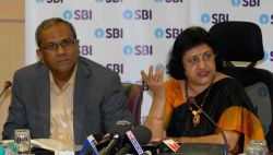 SBI Chairman Arundhati Bhattacharya (R) addresses a press conference in Mumbai on June 9, 2017. Also seen SBI Managing Director B Sriram (L).