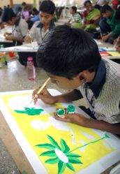 School children from different age groups participating in the painting competition on putting their ideas on Peace in Colors at Mega Peace Poster Painting Competition 2013-14, organized by the International Association of Lions clubs at Lalbagh, in Bangalore on Nov. 9, 2013.