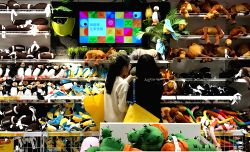 SHANGHAI, Jan. 10, 2017 - Customers choose toys at a shopping center in Shanghai, east China, Jan. 10, 2017. China's consumer price index (CPI), a main gauge of inflation, rose 2 percent in 2016...