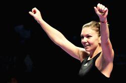 Singapore: WTA finals - Simona Halep celebrates after winning