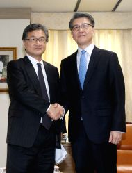 South Korea's nuclear envoy Kim Hong-kyun (R) meets with his U.S. counterpart Joseph Yun in Seoul on March 22, 2017, for talks on North Korea. The two diplomats met as military officials were ...