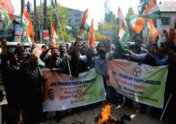 Srinagar: Youth Congress activists stage a demonstration to press for regularisation of daily-wagers working in different departments of the state government in Srinagar, on Oct.25, 2014.