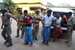 Suri : People arrested in connection with a political clash between Trinamool Congress and BJP workers in Makhra village of West Bengal's Birbhum district, on Monday (27th October), being presented ..