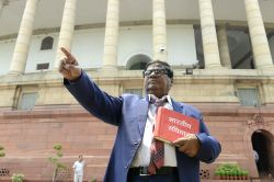 TDP MP Naramalli Sivaprasad poses like Dr B R Ambedkar at Parliament in New Delhi on May 9, 2016.
