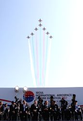 The South Korean Air Force's Black Eagles aerobatic team performs at the opening ceremony of the 2017 Seoul International Aerospace and Defense Exhibition at an airport in Seongnam, south of ...
