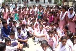 The students of Kadarpur village following steps of Gothra Tappa Dahina school stage a sit-in demonstration to press for upgradation of their school in Gurugram on May 19, 2017. The Haryana ...