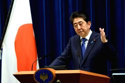 TOKYO, Sept. 25, 2017 - Japanese Prime Minister Shinzo Abe attends a press conference in Tokyo, Japan, on Sept. 25, 2017. Japanese Prime Minister Shinzo Abe announced officially at a press conference ...