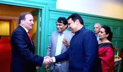Union Commerce and Industry Minister Suresh Prabhu and Maharashtra Chief Minister Devendra Fadnavis meet Sweden's Prime Minister Stefan Löfven during the Business ers Conference in ...