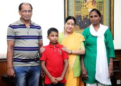 Union Minister for External Affairs Sushma Swaraj welcomes home Sonu, the Indian boy who went missing from Delhi six years ago and was traced in Bangladesh in New Delhi on June 30, 2016.
