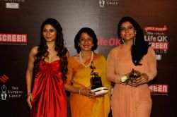 Veteran Actor Tanuja with her daughters and Actors Tanisha Mukherjee and Kajol Devgan during the 20th Annual Life OK Screen Awards in Mumbai, on January 14, 2014.