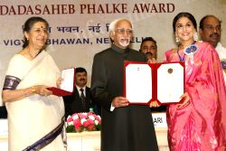 Vice President Hamid Ansari and Information and Broadcasting Minister Ambika Soni presenting best actress award to Vidya Balan at the ''59 National Film Awards'', in New Delhi on Thursday 03 May 2012.