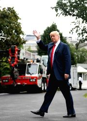 WASHINGTON, Aug. 14, 2017 - U.S. President Donald Trump walks to his office from Marine One as he returns to the White House in Washington D.C., the United States, on Aug. 14, 2017. U.S. President ...
