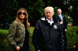 WASHINGTON D.C., Aug. 29, 2017 - U.S. President Donald Trump (R) and First Lady Melania Trump walk to board Marine One before departing the White House for Joint Base Andrews, en route to Corpus ...
