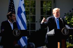 WASHINGTON, Oct. 17, 2017 - U.S. President Donald Trump (R) addresses a joint press conference with visiting Greek Prime Minister Alexis Tsipras at the White House in Washington D.C., the United ...