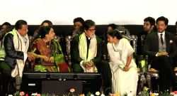 West Bengal Chief Minister Mamata Banerjee with actors Mithun Chakraborty, Shahrukh Khan, Amitabh Bachchan and Jeet during inauguration of 19th Kolkata International Film Festival in Kolkata on Nov.10, 2013.