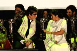 West Bengal Chief Minister Mamata Banerjee with actors Amitabh Bachchan, Jeet, and Dev during inauguration of 19th Kolkata International Film Festival in Kolkata on Nov.10, 2013.