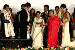 West Bengal Chief Minister Mamata Banerjee with actors Mithun Chakraborty, Shahrukh Khan, Amitabh Bachchan, Prasenjit Chatterjee, Jaya Bachchan and Koel Mallick during inauguration of 19th Kolkata International Film Festival in Kolkata on Nov.10, 2013.