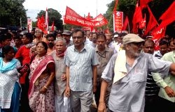 West Bengal CPI-M secretary and Leader of Opposition Surya Kanta Mishra participates in a Left Front rally in Kolkata, on Aug 27, 2015.