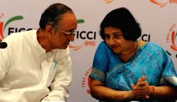 West Bengal Finance Minister Amit Mitra interacts with SBI Chief Arundhati Bhattacharya during FICCI's 14th Banking Conclave 2017 in Kolkata on July 11, 2017.