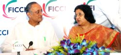 West Bengal Minister Amit Mitra and SBI chairperson Arundhati Bhattacharya during the 12th Banking Conclave 2015 in Kolkata, on Aug 21, 2015.