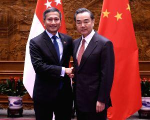 CHINA-BEIJING-WANG YI-SINGAPORE-MEETING