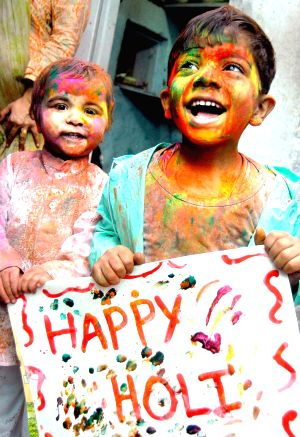 Children at the eve of Holi on New Delhi, 28 Feb 2010.