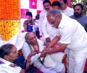 M. Satyanarayana Rao being greeted on his birthday