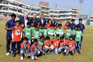 Dean Jones, Bishan Singh Bedi play with children at Feroz Shah Kotla