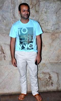 :Bollywood filmmaker Tarun Mansukhani poses during a special screening of film Gippi in Mumbai on May 07, 2013. .